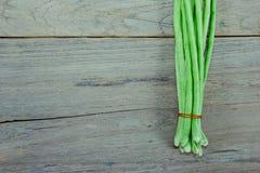 Long beans on wood background Stock Image