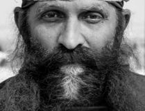A long beard man on Allahabad sangam. stock photos