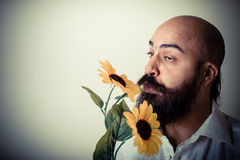 Long beard and mustache man giving flowers Royalty Free Stock Photo
