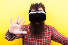 Long bearded hipster wearing a VR virtual reality headset Stock Photos