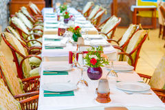 Long beautifully set table Stock Images
