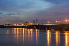Long Bien bridge at sunset. Long Bien Bridge is a historic cantilever bridge across the Red River that connects two districts, Hoa. N Kiem and Long Bien Stock Photography