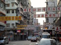 Long and Big Character Shop Signs in Hong Kong. Long street signs hang over the street outside of Hong Kong shophouses on Shanghai Street Royalty Free Stock Photo