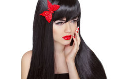 Long black hair. Brunette girl with red lips and healthy hairsty Stock Photography