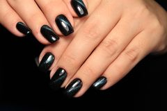 Long black nails. With beautiful fashionable design stock photos