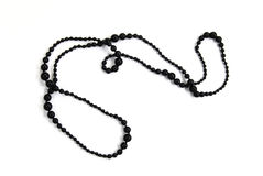 Long black shining necklace Royalty Free Stock Photos