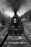 Long Black Train. A long black train photographed in black and white Stock Photography