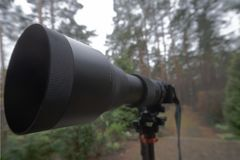 Long black zoom lens with focal length 150 mm to 600 mm on a mirrorless camera on a tripod. Photography stock images