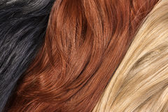 Long blond, black, red human shiny hair Royalty Free Stock Photography