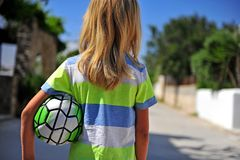 Long blond hair boy with football royalty free stock photo