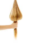 Long blond human hair close-up. Royalty Free Stock Images