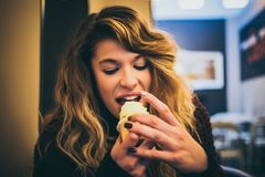 Long Blonde Haired Woman Eating Ice Cream Royalty Free Stock Photo