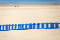Long Blue Fence On The Beach. Royalty Free Stock Photo
