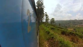 Long blue passenger train Sri Lanka stock footage