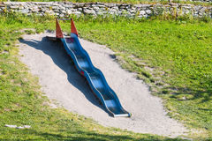 Long Blue and red Metal wave slide Stock Photography