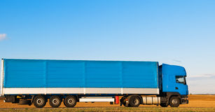 Long blue truck on highway Royalty Free Stock Image