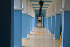 Long blue and white hallway. A view looking down a long, blue and white corridor or hallway Stock Photography