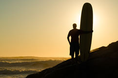 Long boarder watching the waves Stock Photos