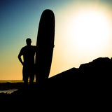 Long boarder watching the waves Stock Photography