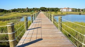 Long boardwalk over marsh Stock Photos