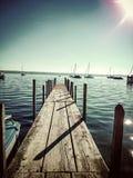 Long boat bridge at the lake. With sunshine Stock Image
