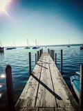 Long boat bridge at the lake. With sunshine Royalty Free Stock Photo