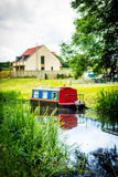 A long boat on canal in Scotland, UK. A long boat on canal in Scotland, Summertime stock image