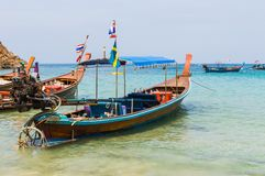 Long boat with engine and tropical beach, Andaman Sea, Thailand Royalty Free Stock Images