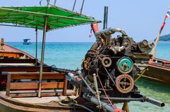 Long boat with engine and tropical beach, Andaman Sea, Thailand Stock Images