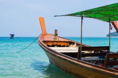 Long boat with engine and tropical beach, Andaman Sea, Thailand Royalty Free Stock Image