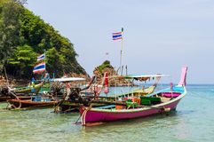 Long boat with engine and tropical beach, Andaman Sea, Thailand Royalty Free Stock Photo