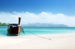 Long boat on island stock photos