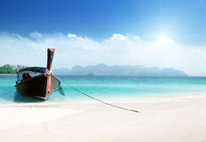 Long boat on island stock images