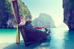 Long boat and rocks on beach royalty free stock image