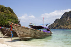 Long boat and tropical beach Stock Photography