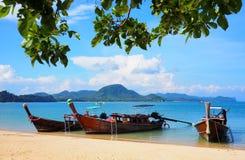 Long boats on a beach in thailand Stock Photos