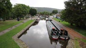 Long boats on canal by Pontcysyllte Aqueduct Llangollen Wales UK stock video
