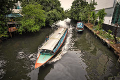 Long boats on canals in Bangkok. Royalty Free Stock Photography
