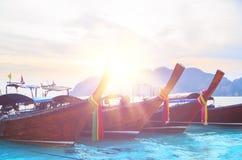 Long boats at tropical beach. Closeup view during sunrise, Andaman Sea,Phi Phi Islands,Thailand Royalty Free Stock Images