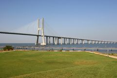 Long Bridge 1. View of one of Lisbon's bridges with a grass lawn in foreground Royalty Free Stock Photos
