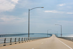 The long bridge. Passing through an ocean gulf Stock Images