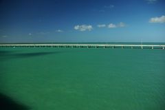 Long bridge. The long bridge surrounded by emerald green ocean. Nice blue sky. Florida Stock Photo