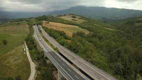 The long bridge along the forest in Italy. With the view of the tunnel going inside the mountain stock video