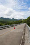 Long bridge cross the river into the mountain. Of Thailand Stock Images