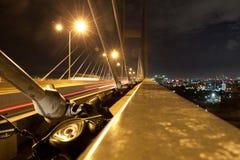 Long bridge in Ho chi minh city at night. motorcycle trip Stock Photos
