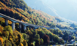 Long bridge in Montreux. Long automobile bridge in Montreux surrounded with colorful autumn trees, Montreux, Switzerland royalty free stock image
