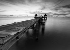 The long bridge over the sea with a beautiful sunrise in black a Stock Photos