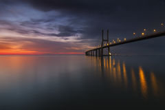 Long bridge over tagus river in Lisbon at dawn Royalty Free Stock Photo