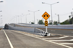 Long bridge with traffic sign of a highway Royalty Free Stock Image