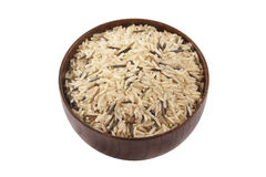 Long brown  rice. On bowl  isolated on white Stock Photo